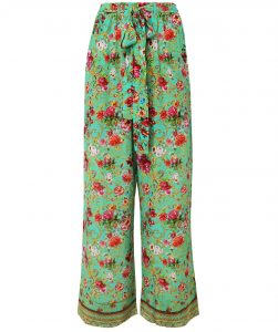 This is an image of some green floral silk trousers