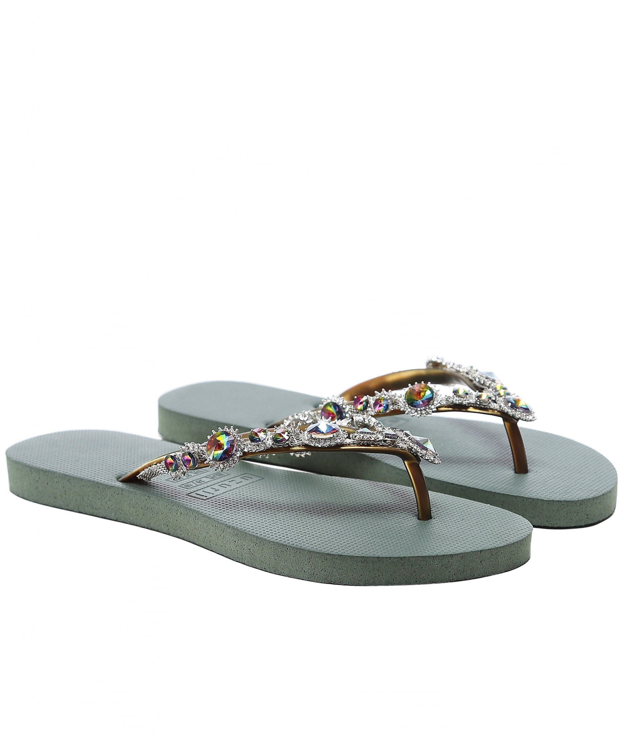 This is an image of a pair of green flip flops with gold straps and crystal embellishment